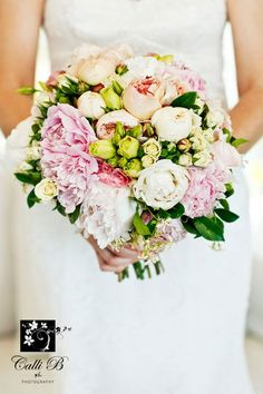 Love all the elements in this bouq, but dare I say its a tad too 'tight' and neat. Just. Bit looser, minus the pink  Hand held unstructured bouquet of peonies, David Austin roses, lisianthus and jasmine and gardenia foliage - Image by Calli B Photography
