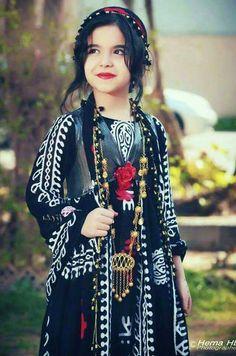 Little Kurdish girl in Rojhelatî Kurdish clothes