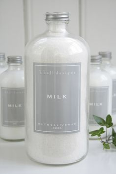 This bath product with white content inside the bottle, grey label, and white typography well represent milk-like product.