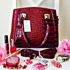 A Dozen Roses Handbag Brand New With Tags! Nothing says 'I love you' like this stunning Dozen Roses Handbag:) Fall head over heels in love with this breathtaking piece. Features a 'spot free' exterior so if anything were to get on it you just wipe and it comes off!:) Description: Exquisite Exterior, Exterior Backside Zippered Pouch, Interior Zippered Pouch, Center Divider, Interior Pocket, Adjustable & Detachable Shoulder/Crossbody Strap.❗️Depending on lighting the coloring can look lighter…