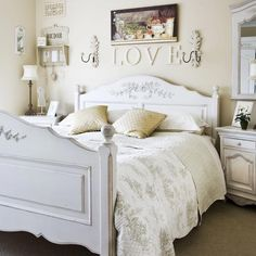 Painted furniture and a toile bedspread gives this bedroom a calming French-style, while the wooden letters above the bed add a touch of romance. The room is kept fresh and bright with an off-white backdrop.