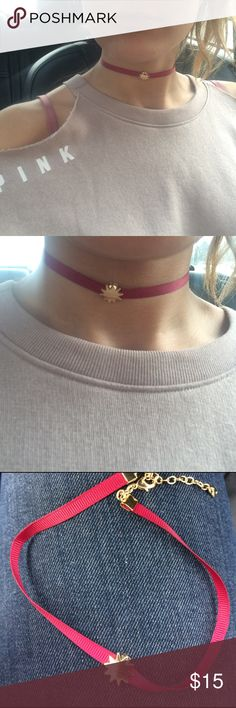 Red ribbon & gold sun star choker necklace ☀️ ⭐️ Red ribbon and gold sun star pendant  choker necklace. new, never worn! Lobster clasp adjustable. Jewelry Necklaces
