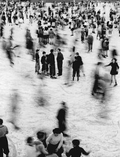 Mario de Biasi People are skating. The people who are in the center of the picture catch my eyes first, and then I move my eyes to individuals who are walking and look blurry. At same moment, some people are moving, and some people are not. I like these are on the picture at same moment.