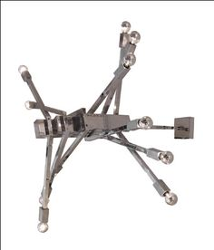 Chrome chandelier with twelve straight arms set at opposing angles.