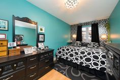"""My old bedroom in Brooklyn - temporary wallpaper accent wall; my beloved light fixture; black & white against a bright """"Teal Zeal"""""""