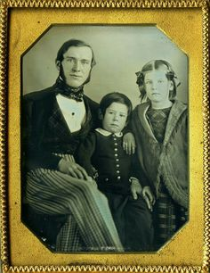 Wonderful, sweet Daguerreotype of father, son and daughter. The little boys hair is combed just like papa's. Definitely 1840s.