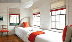 Good solution for  a space-tight guest bedroom. Place the beds foot to foot and curved headboards to fit around the windows.