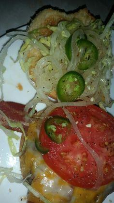 Bacon cheeseburger with jalapeños thin sliced raw onion
