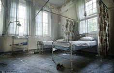 Empty beds: Two pairs of shoes are all that remain of the occupants of these beds at the abandoned Surrey County Lunatic Asylum