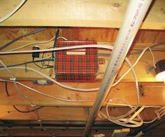 """You were probably wondering where all the old, really cool, plaid lunch boxes went. Here is one in a basement ceiling being used as a 120V electrical junction box. The temptation to peek inside subsided when I read the labels listing the """"STEPS to DISARM.""""   Bill Gray All Star Home Inspection, Inc. Gaithersburg, Maryland courtesy of the ASHI Reporter"""