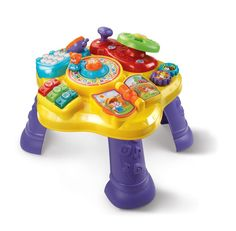 The Magic Star Learning Table by VTech features six fun activities in English and Spanish that encourage your child to explore and learn. Turn the steering wheel to drive the bear around the activity table, flip the book page to hear nursery rhymes and turn the gears to strengthen fine motor skills.