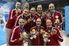 The Canadian women's synchronized swimming team show off their golds medals after winning the women's synchronized swimming team final at CIBC Aquatic Centre/Field House in Toronto on July 11, 2015. Pan Am Games - STEVE RUSSELL / TORONTO STAR