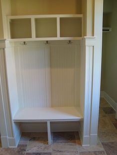 Mudroom nook in space similar in size to a coat closet.