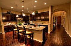 Pulte Homes Interior - Love the open concept and the warm, rich wood. Love the open kitchen