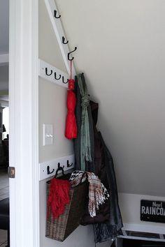 DIY angled stairwell coat rack basement stair way space savers Stairway Storage, Basement Stairway, Wall Storage, Storage Stairs, Basement Ceilings, Basement Bars, Walkout Basement, Attic Storage, Basement Flooring