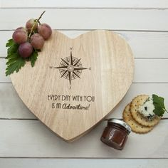 An utterly romantic gift for the love in your life!  Designed in the style of a compass.   Heart cheese board with integrated speciality knife compartment, made from sustainable Hevea wood.      Includes 3 wooden handled specialist cheese knives with stainless steel handles.     Rotating knife compartment.     Made from Hevea wood which is environmentally friendly.  - Cheese Fork - Stilton Knife - Cheddar Knife   Please fill in the personalisation fields to the right of the page…