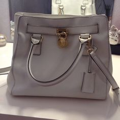 Authentic Michael Kors Purse Worn a few times still in good condition, only flaw is in the back of the purse there is a blue stain from rubbing against jeans, inside looks brand new everything that is described is pictured above, but this purse is cute for any event! Especially for shopping!!! Willing to take best offer :) Michael Kors Bags