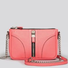 Milly Jayden Mini Bag NO LONGER SOLED IN STORES! Adorable genuine leather GENUINE Milly! Used twice! Practically perfect! Note the bright pink color versus the stock photo. It's a BRIGHT pink. Black accents and silver chain- perfect for any outfit. NO TRADES- will accept reasonable offers! Milly Bags Mini Bags