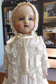 This is a wax-over-composition headed German Motschmann baby doll, probably made from circa 1850 on in Germany by Heinrich Steir or other Sonnenberg factories. This baby has the remnants of softly painted curls on each side of the head, blue glass eyes, and an open mouth with a few tiny teeth appropriate for a baby. | eBay!