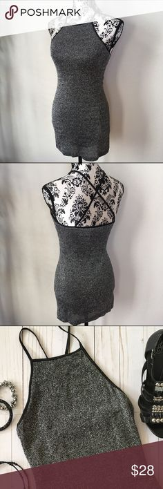 "Black & silver metallic stretch knit dress Super sexy. Cross cross spaghetti strap metallic body con dress. Stretchy viscose rayon metallic knit dress with nylon lining. Measurements laying flat: armpit to armpit 14"" stretching to 17"", length from top of front 28"". Excellent condition. Guess Dresses Mini"