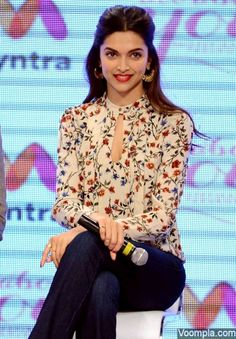 Deepika Padukone wearing a floral top and jeans by her own fashion label All About You. via Voompla.com