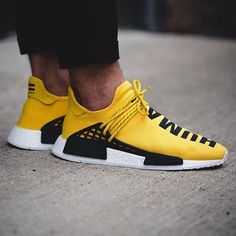 The adidas Originals = PHARRELL WILLIAMS Hu NMD have arrived. With 'Hu' representing Human Being, Human Race, Human Kind and Human Species, Pharrell's Hu NMD stays true to adidas Original DNA with the latest breakthrough in technology that we've come to love. The pair features a yellow upper Primeknit with a split 'Human Race' graphic combined with the energy-returning white Boost midsole. The latest edition also features a new lacing system giving the wearer more support and freedom, re...