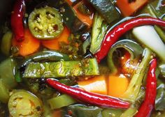 Poblanos en Escabeche is just one of the many combinations of a quick pickled escabeche I have prepared. What happens most times, is that I get to that point where I have a few of this and that, ve...