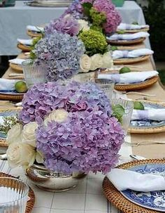 Perfect Blue willow Engagement party styling - with burlap table cloth, hydrangea and white rose centerpieces, and cane chargers to complete the look. Table Arrangements, Floral Arrangements, Hydrangea Wedding Arrangements, Flower Arrangement, Purple Wedding, Wedding Flowers, Ivory Wedding, Elegant Wedding, Purple Centerpiece Wedding