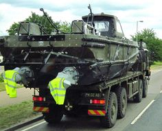 Army boat being transported on Army flatbed truck June 2014 2