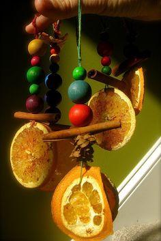 Solstice ornaments, rainbow, beads, cinnamon and orange
