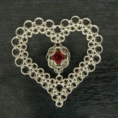 maybe a or size dice that will fit in the center . Valentine's Day Revisited by rogaty on deviantART Wire Wrapped Jewelry, Metal Jewelry, Jewelry Art, Jewelry Accessories, Jewelry Design, Jump Ring Jewelry, Heart Jewelry, Chainmail Patterns, Chainmaille Bracelet