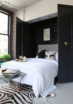 9 stylish murphy beds for small spaces. Whether for your studio, small bedroom, guest room or living room, these stylish murphy bed ideas make the most of this small-space essential. For more home furniture ideas go to Domino. Beds For Small Spaces, Small Space Living, Decorating Small Spaces, Small Apartments, Living Spaces, Decorating Ideas, Decor Ideas, Small Condo, Living Area
