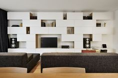 Living room in a renovated Ljubljana, Slovenian apartment, with white built-In shelves - designed by architect Lidija Dragisic.