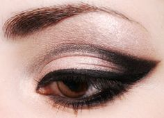 Eyeshadow. use scotch tape in the outer corner to get an even crisper line.  i tried it and it works great.