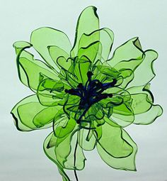Discover thousands of images about Recycled plastic bottle flowers! Use this idea for making colorful, light, water-resistant undersea creatures and plants Ties to Chihuly and recycled art. Its recycled plastic waterbottles made into flowers! Reuse Plastic Bottles, Plastic Bottle Flowers, Plastic Recycling, Flower Bottle, Plastic Bottle Crafts, Plastic Spoons, Plastic Art, Recycled Bottles, Recycled Art Projects