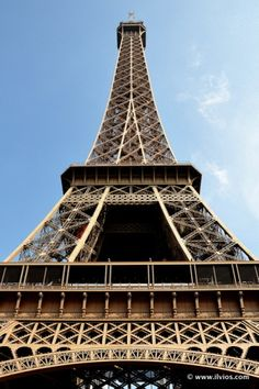 In the shadow of Eiffel Tower - Paris, France.