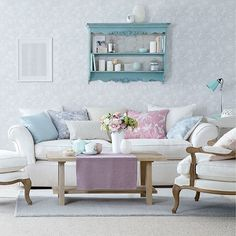 Duck egg living room with wall shelf unit and pastel cushions