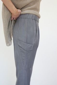 Beklina : Rogan Alya Pants $270. Soft washed silk twill skinny pant with hidden zippers at leg opening. Geometric pockets and hidden front slit pockets. Elastic waist. Dry clean. 100% Washed Silk Twill in storm.
