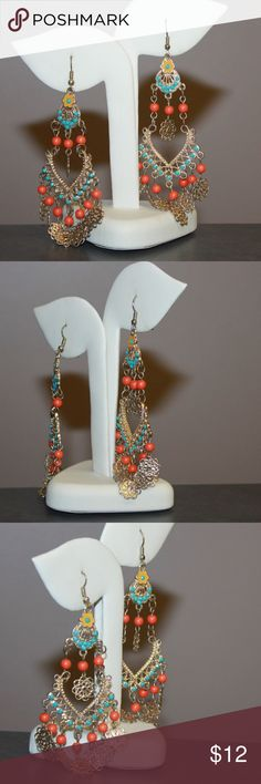 India Style Chandelier Dangle Earrings Gold Tone 2/18-JB360 Amazing pair of gold tone filigree chandelier dangle earrings featuring beads of faux turquoise and coral. Overall good vintage condition. Each earring measures 4 inches tall. Total weight of 0.54 ounces. All jewelry / accessories come with a gift box and are usually sent out same day or next day (business days). Please examine the pictures closely, as we consider them to be a part of the description. Jewelry Earrings
