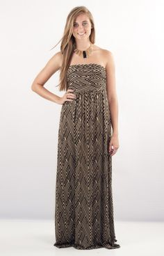 Hourglass Lilly 2329MAZTBLK is a sassy black and taupe printed maxi! This perfect fit is designed to fit snug around your bust and flow straight down your figure. You will fall in love with this dress!