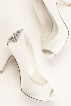 Truly Zac Posen satin peep toe pump.  Satin peep toe pump with hidden platform and jeweled embellishment on back counter.  Heel height: 4 inches. Platform 1/2 inch.  Available in Ivory.  Imported.