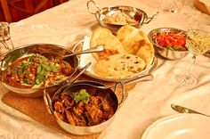 Indian supper for two- Lamb Rogan Josh, okra, baby corn, and paneer sabzi,salad, and Kasimir Naans