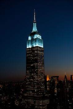 December 2, 2014: The Empire State Building glimmers in light blue and white to honor UNICEF and its 10th annual Snowflake Ball.
