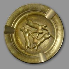 Three hares - looks like an ashtray, but I'm prepared to overlook this fact for the pleasure of the hare decoration.