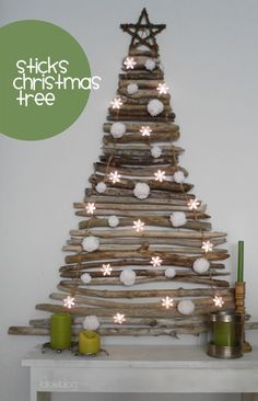 Beautiful DIY stick Christmas tree over a fireplace mantel