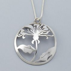 After drawing the image of a wild thistle, this pendant is then peirced entirely by hand, shaped and polished.Materials: sterling silverDimensions: 4.5cm wide x 4.5cm high x 1cmI am happy to do custom orders, please contact me to order your thistle pendant in a different metal or with the addition of gemstones.