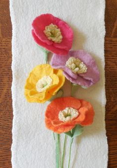 A hand felted poppy flower with leaves in your choice of color. Each flower has been wet felted using merino wool and has an attached stem