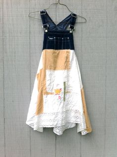 sweet but funky little tunic dress for work or play - made from upcycled overalls and cotton. the sides split so you will need to wear leggings under it or let me know and i can stitch it closed. lots of funky in this little dress. you will love how this dress hangs and flows * color palette - denim, hand dyed creme brulee and white.   *would look great with a pair of boots, leggings or over jeans SIZE - as is - XSmall - Small - i can adjust larger - just let me know at checkout. Chest - 17…