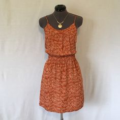 Madewell Broadway & Broome Summer Dress Adorable!!  100% rayon slinky smooth feel. Adjustable spaghetti straps, elastic waste, short zipper on upper back, HAS POCKETS!! Has 6 little pleats on front of bodice for fit and visual interest. Very cute pattern, rust colored. Size 0, TTS. Bust measured flat across is approx. 16.5 inches, length measured from the front center of bust to hem is 28.5 inches. This is a Beautiful dress in PERFECT CONDITION!! Madewell Dresses