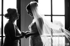 window backlight=beauty  Moment between mom and bride